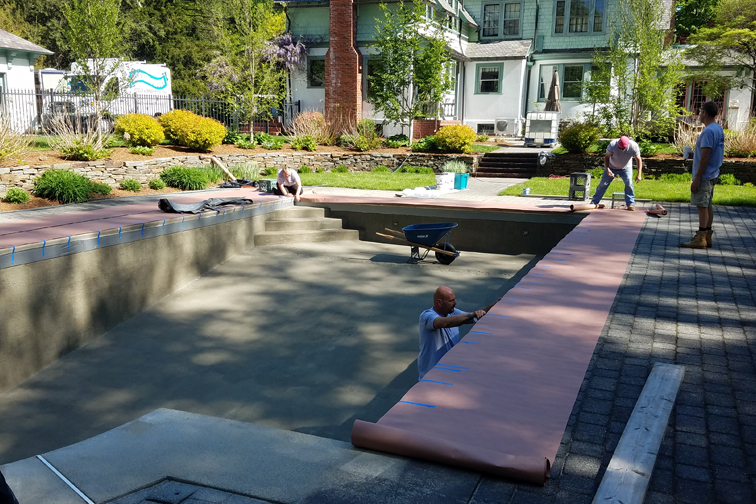This is a photo of a gunite inground pool restoration in-progress in Longmeadow, MA
