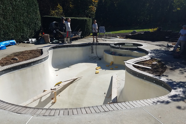 This is a photo of a gunite inground pool restoration in-progress